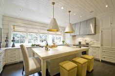 The Goodman Hanging Lights by Thomas O'Brien in Antique White are great in this yellow and white kitchen!