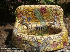 An old sink repurposed with mosaic tiles for a bird bath. Hmm.... I could come up with a number of great bird sanctuary ideas with an old sink.