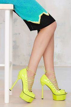 Screw it, you need these platforms by Jennifer Chou. They have a neon yellow upper with lace-up detailing, a screw-inspired heel, and towering platform. Genuine leather lining, cushioned insole. Wear them with dark wash skinnies and a distressed vintage tee for a night out with your gal pals.