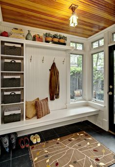 This bench runs right into the corner. There are shelves and hooks along the wall, and the corner adds a nice clear and open element. Style At Home, Sweet Home, Entryway Storage, Entryway Ideas, Shoe Storage, Storage Baskets, Bench Storage, Organized Entryway, Storage Shelves