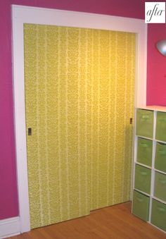 wallpapered closet doors..or you could paint/stencil them Interesting idea!