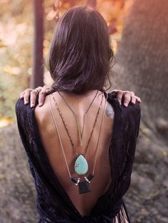 Cool way to switch up how you wear long necklaces - and jazz up a backless top!