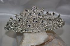 make a tiara for your little princess with your embroidery machine and thread  and a few rhinestones https://www.etsy.com/listing/228747749/tiara-crown-freestanding-lace-machine