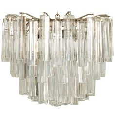 20th Century Scandinavian Tiered Crystal Chandelier by Camer Glass | From a unique collection of antique and modern chandeliers and pendants at https://www.1stdibs.com/furniture/lighting/chandeliers-pendant-lights/