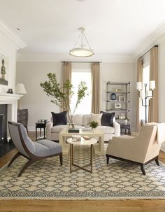Light beige walls, white trim, blue accents living room - S. B. Long Interiors