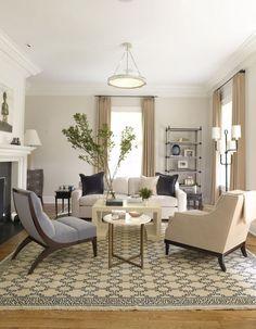 Light beige walls, white trim, blue accents living room - S. B. Long Interiors
