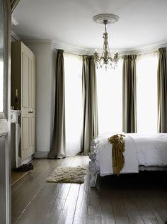 bedroom - drapery - chandelier - wood floor