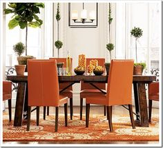 The red-orange color is beautiful for the dining room.  This shade of red + hardwood floors + dining room table + natural light