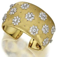 18 Karat Gold and Diamond Cuff Bracelet, Buccellati.  Round diamonds weighing approximately 8.00 carats, mounted in 18 karat white and yellow gold, internal circumference 6¾ inches, signed M. Buccellati, Italy. $40,625.00