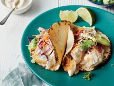 Fish Tacos and Topping Bar Recipe | Fresh fish tacos are topped with Asian Slaw and Quick Chipotle Cream for a dinner recipe that the whole family will love.