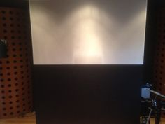 This is the live room at Quince studios (just one wall mind). In this shot you can see partly how the room has been controlled using bass traps and sound absorbers. There are also diffusers used at quince and sound reflectors.