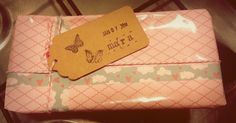 Baby shower present. Wrapping, pink, washi tape, bakery twine, label, stamps