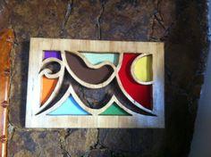 Cuadro escultórico en madera.