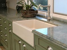 showing the white sink with a med tone color cabnet and counter here they are greening Im thinking more with the warn wood/brown tone accent with color