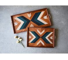 This wooden serving tray can give any area of the home a cozy, yet modern appearance... Created by hand, this piece has a symmetrical, geometric pattern. The trays displayed in the photos above are 12 x 16 and 12 x 24. This wood serving tray has been sealed with lacquer and is