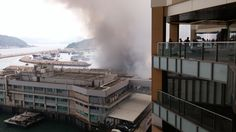 Street Photography - Light/Dark - Fire / Exploding boats in Shau Kei Wan Typhoon Shelter. I took this photo from Grand Promenade in Sai Wan Ho.
