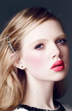 """I'd love this look with a bit more brow to make her eyes pop instead of look on """"off""""! Bright lips + lush lashes."""