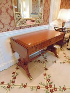 Lot 128 - A mahogany sofa table in George IV style, the banded drop-leaf oblong top with a reeded edge above