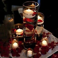 Floating candles and rose petals make easy wedding table decorations. Red wedding decorations can be very easy to over-do though. Wedding Table Centerpieces, Centerpiece Decorations, Christmas Centerpieces, Floating Candle Centerpieces, Centerpiece Flowers, Floating Candles Wedding, Romantic Centerpieces, Red Rose Centerpieces, Halloween Wedding Centerpieces