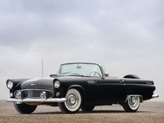 My dream car: A 1957 Ford Thunderbird Hard-top Convertible in blue. Or a Bentley Continental GT in silver. Ooooh or a 1950 Jaguar XK 120 Roadster, though they're extremely impractical.