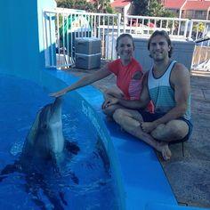 bethany hamilton and adam dirks | ... dolphin, Bethany Hamilton (center) and her husband Adam Dirks (right