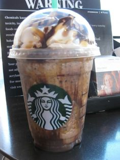 Twix Frappachino- Caramel frappachino with extra caramel and mocha drizzle in the cup, whipped cream blended in, one pump of hazelnut, and java chips