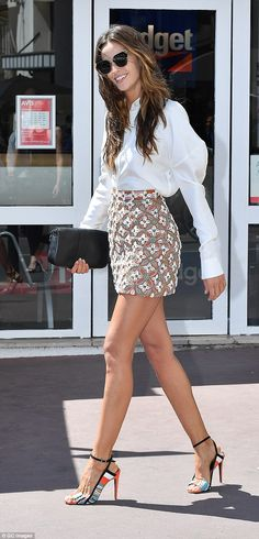 Mixing and matching: She completed her Fendi ensemble with fun Pierre Hardy sandals...