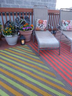 """Floor coverings come in many sizes, and help define living spaces. Try this two-toned DIY version (courtesy of masking tape and spray paint), which can break up a small deck into separate """"rooms"""" for eating and lounging. Get the tutorial at Design Improvised »  - GoodHousekeeping.com"""
