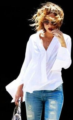 Comfy cool in a flowy white blouse and jeans.