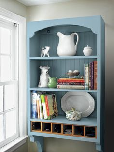Old-timey kitchens were smaller. Plate racks and hanging shelf units took up less room than freestanding hutches and sideboards. This piece's graceful arch, curved brackets, and beadboard back are traditional touches; the cubby organizer updates it for today.