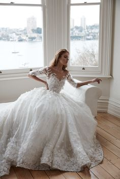 Steven kahilil wedding gown featuring a-line bodice and hand made flowers