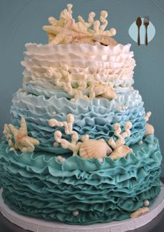 Under the sea coral and shell ruffle ombre cake in blue