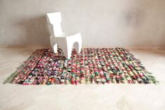 MOROCCAN VINTAGE BOUCHEROUITE RUG THE BOUCHEROUITE rug is made for domestic use out of recycled scraps of nylon, cotton, and sometimes wool. The