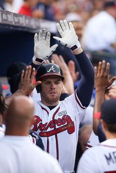 Freddie Freeman #5 of the Atlanta Braves celebrates with teammates after hitting a two-run home run against the Washington Nationals during the second inning at Turner Field on August 8, 2014 in Atlanta, Georgia.