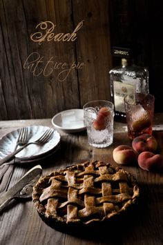 Peach Lattice Pie on plate, glass in hand by Asha | Fork Spoon Knife