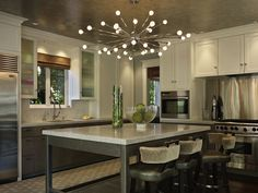 Toth Construction: Contemporary kitchen design with sputnik chandelier over industrial kitchen island with ...