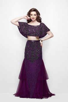 Primavera Sizzle in this fantastic two piece evening gown. The top has a sheer cape embellished with beaded detail throughout. The skirt is with a fitted silhouette and sheer flared edges. A fine beading rounds the waist and a sparkling assymetric beading lingers on the skirt. It‰۪s a look that oozes glamour. Available in Blush & Plum.