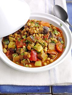 This recipe for Moroccan veg and chickpea tagine is vegan, low-fat and really easy to make. This makes enough for four, but the leftovers freeze well.