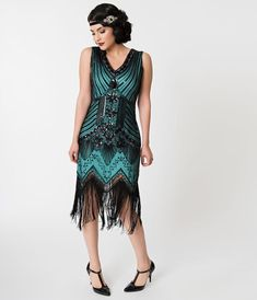 This elegant Roaring blue green fringe flapper dress is a Unique Vintage exclusive, and a retro deco dream. Sparkling black sequins and beads dazzle, 20s Dresses, Unique Dresses, Fashion Dresses, Flapper Dresses, 1920s Style Dresses, Bride Dresses, Dance Dresses, Girls Dresses, Bridesmaid Dresses