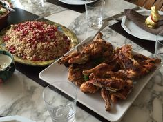 Harissa-spiced poussin servEd with - Allspice pilaf with coconut, pomegranate and hazelnuts.