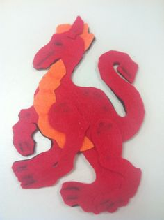 A little late for Chinese New Year, but I've been working on this latest felt project for a while. I borrowed the pattern from Phee McFadd. Felt Stories, Flannel Boards, Lunar New, How To Fall Asleep, Dinosaur Stuffed Animal, Stitching, Applique, September, Dragon