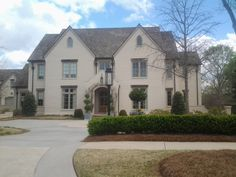 Newhave home designed by Mitch Ginn - coated brick - cedar shake roof - tudor… Brick Houses, Exterior Color Schemes, Stucco Homes, Tudor Style Homes, Cabins And Cottages, Beautiful Architecture, Design Firms, Future House, Shake