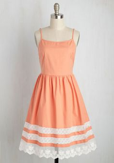 Captivate everyone's attention at the open mic in this peach sundress! As the stage lights illuminate the delicate spaghetti straps and layers of bright white, crocheted lace around the hem of this cottony frock, you feel the eyes of the audience anticipating your perfect performance to come.