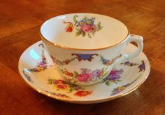 Here is a lovely Hammersley & Co. Bone China cup and saucer set in pattern no. 472. Beautifully decorated with floral swags draping from five blue