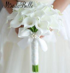 Item Type: Wedding BouquetModel Number: ZC16091402Brand Name: modabelleMaterial: PolyesterPlace of Origin: Jiangsu, China (Mainland)Season: Spring,Summer,Autumn,Wintercalla lily bouquet: bridesmaids bouquet Vintage 2017 CustomHand Bridal FlowersDecor