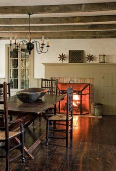 A simple colonial mantel dresses the fireplace in the dining room.  Perfection