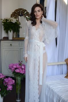 LONG LACE-TRIMMED TULLE BRIDAL ROBE This translucent long robe is created for elegant and confident women. Lace-trimmed sleeve-bells create so easy and weightless look! Bride Lingerie, Wedding Night Lingerie, Pretty Lingerie, Beautiful Lingerie, Vintage Lingerie, Honeymoon Lingerie, Wedding Robe, Wedding Dresses, Tulle Wedding