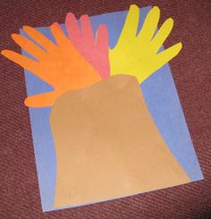 Volcano Craft with hands traced on colored paper