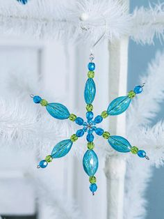 Ornament Flurry Bedazzled with beads, these pretty snowflake ornaments are made from jewelry-making supplies. Use beads in colors that match your decor, or use a combination of clear and white beads for a traditional snowflake motif.