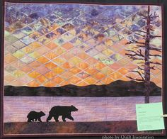 Tahoe Sunrise by Charlene Dakin. 2015 DVQ show (California). The mosaic sunrise was based on a class by Gloria Loughman. Photo by Quilt Inspiration.